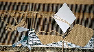 [Weaving on Loom]